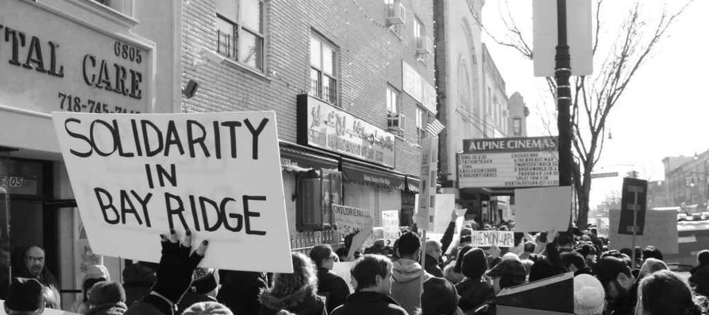 Activists rally at the start of the Martin Luther King, Jr. Day March for Visibility Against Hate in Bay Ridge