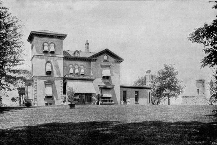 View of Eliphalet Bliss's mansion in Owl's Head Park with his observation tower in the background.